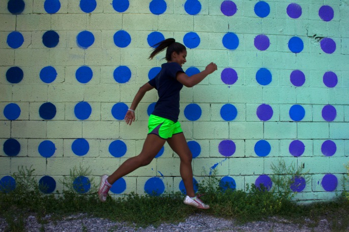@brittany.adele running in front of the 17x180 foot gradient mural in Chattanooga